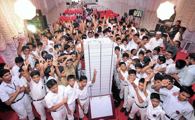 Students of Ideal institutions with the Mega Mag 2014 that they released on Thursday. / The Hindu