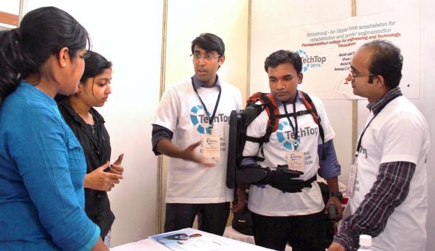 Students from the Pankajakasthuri College of Engineering and Technology show the working of 'Armstrong,' an upper-limb exoskeleton for rehabilitation and power augmentation, at the TechTop National Innovation Challenge 2014 in the city. / The Hindu