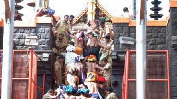 Pilgrims climbing the holy steps of Lord Ayyappa temple | Shaji Vettipuram