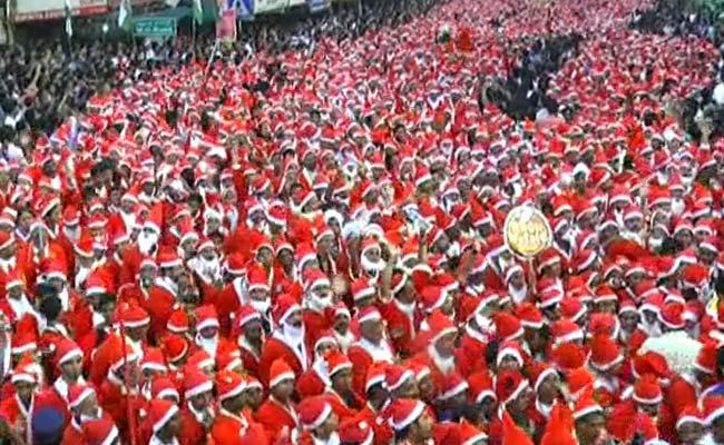 People in huge numbers dressed as Santa Claus in Thrissur in Kerala