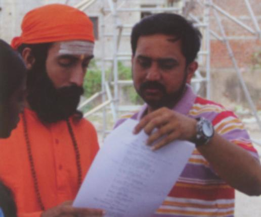 THE MAN BEHIND: Director Prasanna with Sandeep Hebber in the role of young Swami Chinmayananda. Photo: Special Arrangement