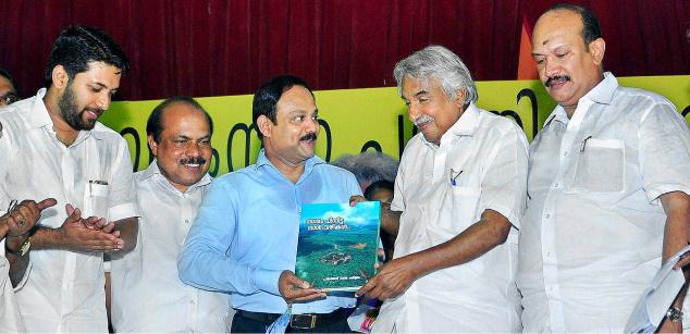 Chief Minister Oommen Chandy releasing ''Nagaram Pinnitta Naalvazhikal,' a collection of memoirs on Palakkad's last 150 years by handing over a copy to industrialist Siddique Ahmed at a function on Monday. Shafi Parambil MLA, Public Works Minister V. K. Ebrahim Kunju and municipal chairman P. V. Rajesh are also seen. —Photo: K. K. Mustafah