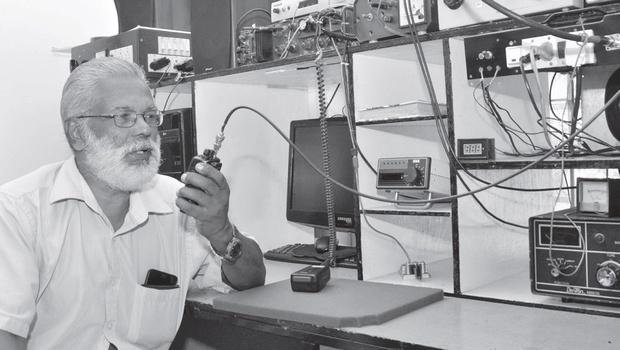 Mathachan Ashan operating his ham radio at his residence in Idukki (photo courtesy: Vincent Pulickal)