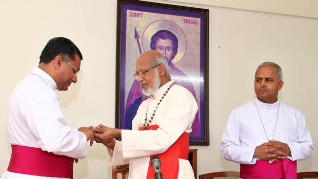 Syro-Malabar Church head Mar George Cardinal Alencherry adorning episcopal insignia with Msgr Stephen Chirapanath who has been appointed Apostolic Visitator to Europe. Fr Joseph Srampickal (R) who has been appointed Bishop of the newly-formed Syro-Malabar Church diocese in Britain looks on, in Kochi on Thursday | Albin Mathew