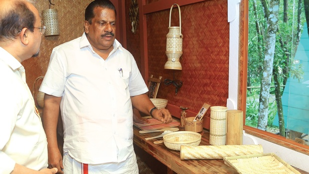 Industries Minister E P Jayarajan checks out the bamboo products at Bamboo Innovation Centre after the inauguration at Angamaly on Tuesday