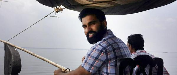 Indian American Democrat Peter Jacob at the helm of a houseboat at Kumarakom during his visit to Kerala in 2015.